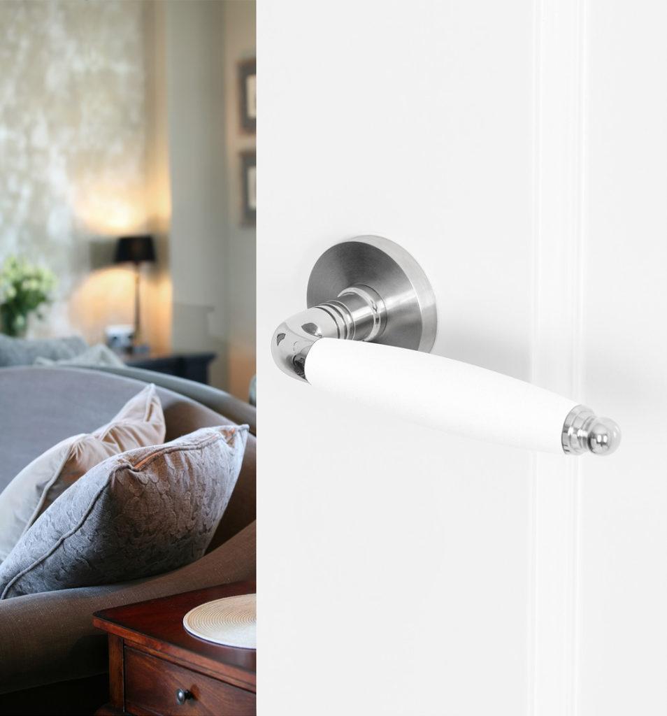Jaren '30 deurkruk Ika in RVS en wit